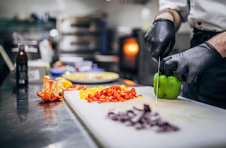 Food Preparation with gloves on for food hygiene